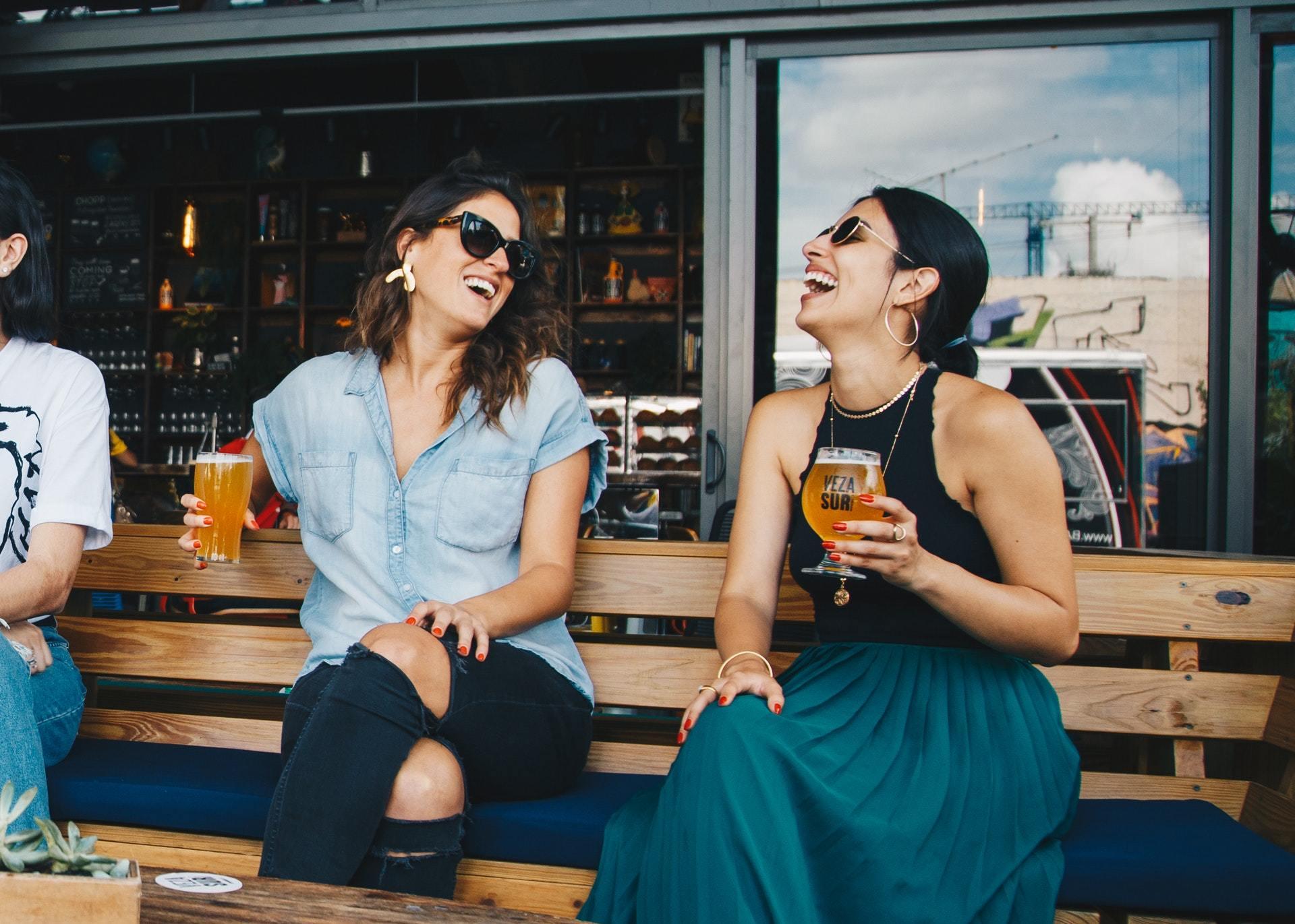 2 girls enjoying drinking alcohol moderately